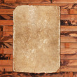 Weathered aged paper sheet on a wooden background - Foto de Stock