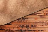 возрасте ткани на фоне деревянные — Стоковое фото