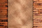 Pano resistido em um fundo de madeira — Fotografia Stock