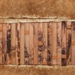 Grungy paper sheet on a wooden background — Stock Photo