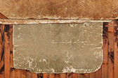 Vintage damaged papers on a wooden background — Stock Photo