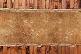 Vintage damaged paper on wood — Stock Photo