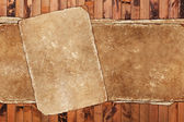 Damaged aged paper on a wooden background — Stock Photo