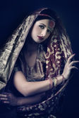 Beautiful brunette portrait with traditionl indian costume — Stock Photo