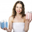 The beautiful girl smiling holds a gift in a boxes. — Stock Photo