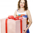 The beautiful girl smiling holds a gift in a box — Stock Photo