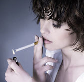 Woman smoking a cigarette — Stock Photo