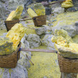 Basket full of sulfur nuggets atop — Stock Photo
