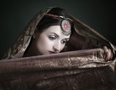 Beautiful brunette portrait with traditional costume — Stock Photo