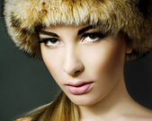 Beautiful woman wearing fur — Stock Photo