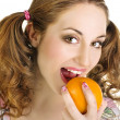 Pretty young woman with orange — Stock Photo