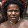 A traditional  papua woman in a village near Wamena - Stock Photo