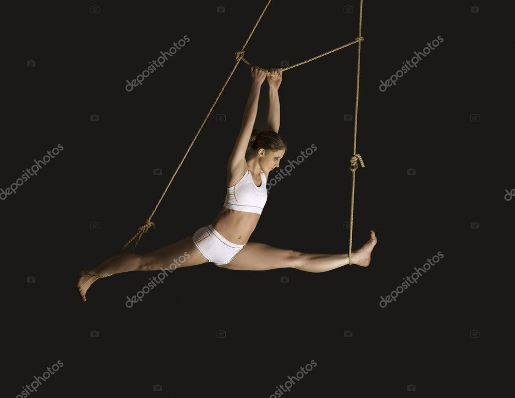 Young woman gymnast. On black background  Stock Photo #9656533