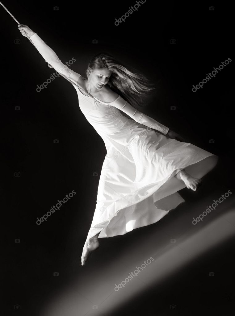 Attractive young dancing woman  on rope in white dress  Stock Photo #9794981
