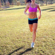 Stock Photo: Beautiful Brunette Jogging Outdoors (1)