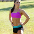 Stock Photo: Beautiful Brunette Ahtlete Stretches Outdoors (1)