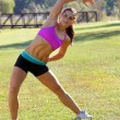 Beautiful Brunette Ahtlete Stretches Outdoors (3) — Foto Stock #8067640
