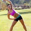 Stock Photo: Beautiful Brunette Ahtlete Stretches Outdoors (4)