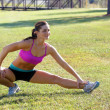 Stock Photo: Beautiful Brunette Ahtlete Stretches Outdoors (5)