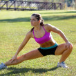 Stock Photo: Beautiful Brunette Ahtlete Stretches Outdoors (6)