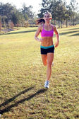 Beautiful Brunette Jogging Outdoors (1) — Stock Photo
