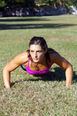Beautiful Brunette Does Pushups Outdoors (1) — Stock Photo
