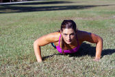 Beautiful Brunette Does Pushups Outdoors (2) — Stock Photo