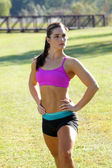 Beautiful Brunette Ahtlete Stretches Outdoors (1) — Stock Photo
