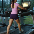 Beautiful Female Athlete on a Treadmill (2) - Stock Photo