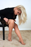 Beautiful Blonde Putting on Panty Hose (2) — Стоковое фото