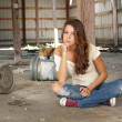 Beautiful Brunette Sitting in an Abandoned Warehouse (3) — Stock Photo