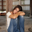 Beautiful Brunette Sitting in an Abandoned Warehouse (4) — Stock Photo