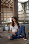 Beautiful Brunette Sitting in an Abandoned Warehouse (1) — Stock Photo