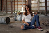 Beautiful Brunette Sitting in an Abandoned Warehouse (2) — Stock Photo