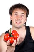 The smiling man with tomatoes on a white background — Stock Photo
