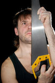 The man with the tool on a black background — Stock Photo