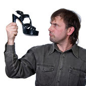 The man with a shoe — Stock Photo