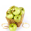 Green apples in a gold basket — Stock Photo