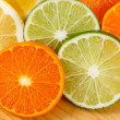 Sliced Citrus Fruit, Limes, Lemons and Oranges — Stock Photo #10447143