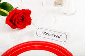 Close up of Reserved Restaurant Table with Red Rose — Stock Photo