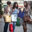 Happy girls doing shopping — Stock Photo