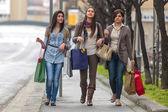 Happy girls doing shopping — Stock Photo