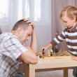 Son and father playing chess at home — Stock Photo