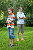 Conflict of father and son, park — Stock Photo