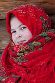 Russian beauty in a red scarf. — Stock Photo