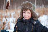 Portrait of boy wearing hat, sedge, winter — Stockfoto