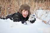 Boy lay on snow and cries, winter — Stock Photo