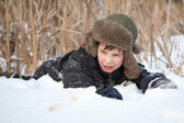 Boy lay on snow, winter — Stock Photo