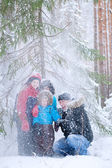 Father and three sons in winter forest — Stock Photo