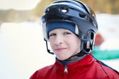 Portrait of teenager wearing helmet, winter — Stok fotoğraf